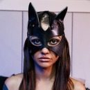 Classic cat mask with a tear. фото 1